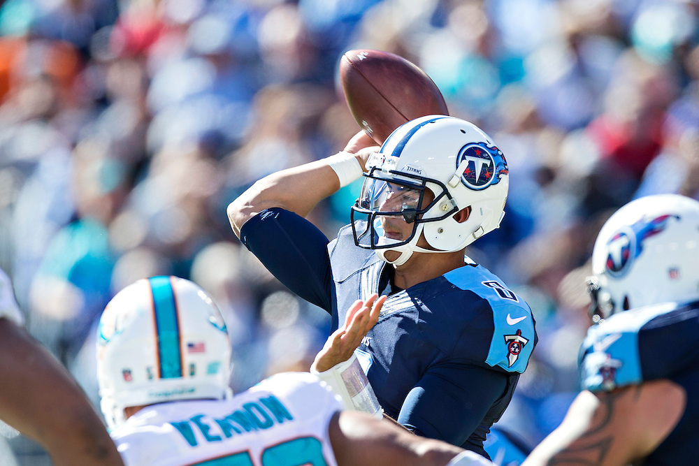 NASHVILLE, TN - OCTOBER 18:  Marcus Mariota #8 of the Tennessee Titans throws a pass under pressure during a game against the Miami Dolphins at LP Field on October 18, 2015 in Nashville, Tennessee.  The Dolphins defeated the Titans 38-10.  (Photo by Wesley Hitt/Getty Images) *** Local Caption *** Marcus Mariota
