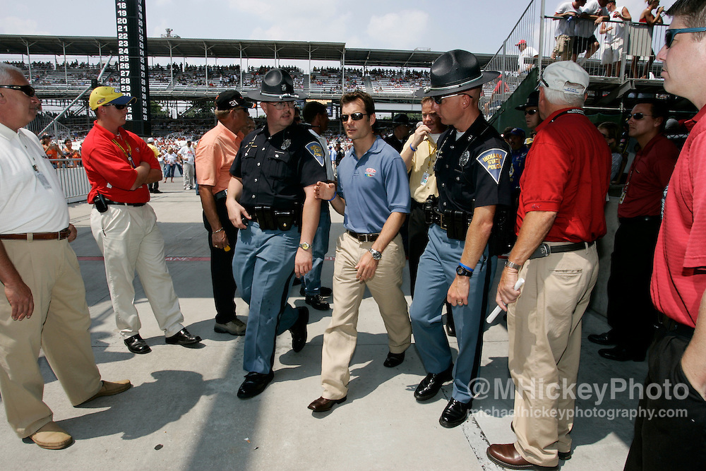 Jeff Gordon is escorted by security after the driver's meeting before the Allstate 400 at the Brickyard Aug 7, 2005 in Indianapolis, IN.