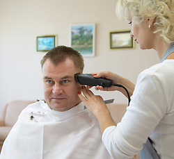 October 9, 2018 - Baikonur, Kazakhstan - Expedition 57 Flight Engineer Alexey Ovchinin of Roscosmos gets his hair cut, Tuesday, Oct. 9, 2018 at the Cosmonaut Hotel in Baikonur, Kazakhstan. Ovchinin and Expedition 57 Flight Engineer Nick Hague of NASA are scheduled to launch onboard a Soyuz rocket October 11 and will spend the next six months living and working aboard the International Space Station. (Credit Image: ? Bill Ingalls/NASA via ZUMA Wire/ZUMAPRESS.com)