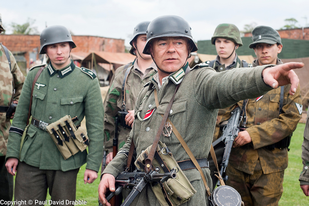 Reenactors of the NWW2A Portraying a Panzer Grenadiers from the Großdeutschland Division prepare for a battle reenactment at Fort Paull on Sunday ..5 May 2013.Image © Paul David Drabble