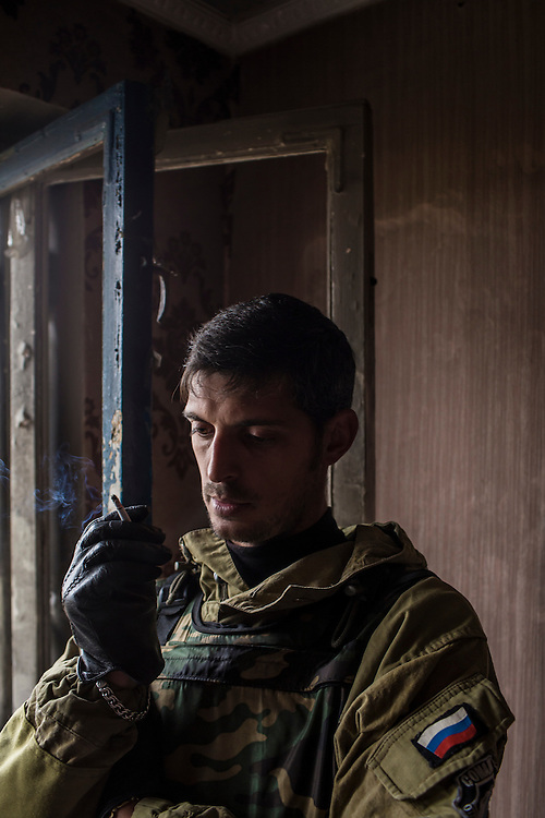 Pro-Russian rebel commander Mikhail Sergeevich Tolstikh, known as Givi, in an apartment building where his forces can observe and coordinate fighting to gain control of the Donetsk airport on Friday, October 17, 2014 in Donetsk, Ukraine.