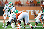 AUSTIN, TX - AUGUST 30:  Josh Greer #8 of the North Texas Mean Green calls a play against the Texas Longhorns on August 30, 2014 at Darrell K Royal-Texas Memorial Stadium in Austin, Texas.  (Photo by Cooper Neill/Getty Images) *** Local Caption *** Josh Greer