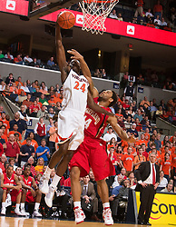 Virginia guard/forward Mamadi Diane (24) is fouled on his way to the basket by Maryland guard/forward Sean Mosley (14).  The Virginia Cavaliers defeated the Maryland Terrapins 68-63 at the John Paul Jones Arena on the Grounds of the University of Virginia in Charlottesville, VA on March 7, 2009.