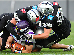 28.05.2011, Tivoli Stadion, Innsbruck, AUT, EFL Halbfinale, Swarco Raiders Tirol vs Raiffeisen Vikings, im Bild Christoph Gross, (Raiffeisen Vikings, #8, QB) wird von der Raiders Defense gestoppt,  EXPA Pictures © 2011, PhotoCredit: EXPA/ T. Haumer
