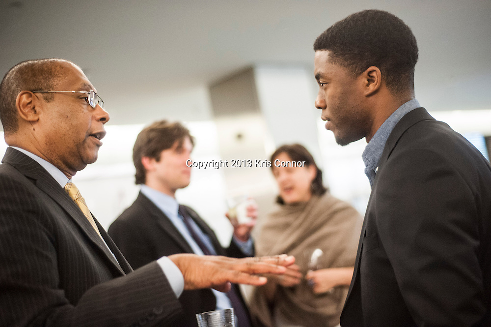 "WASHINGTON, DC - APRIL 15:  Chadwick Boseman speaks with guests during the Washington DC screening of Warner Bro's film ""42"" at Smithsonian Museum of American History on April 15th, 2013. Guests included star of the film Chadwick Boseman, John Gray, Carol Melton, and Lonnie Bunch. Photo by Kris Connor/Warner Bros"
