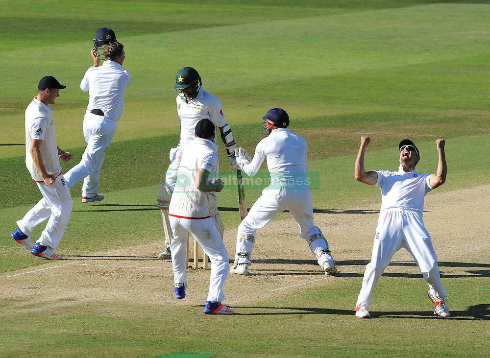 England captain Alastair Cook, right, celebrates after Moeen Ali caught and bowled Pakistan's Sohail Khan and England beat Pakistan by 141 runs during day five of the 3rd Investec Test Match at Edgbaston, Birmingham.