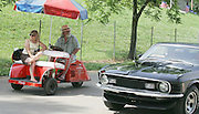 David W. Smith/ Daily News<br /> Derrell and Susan Dudley from New Braunfels TX, watch  hot rods while they drive their 1950 Pushman golfcart during the Hot Rod Reunion Thursday at the Beech Bend Campground.