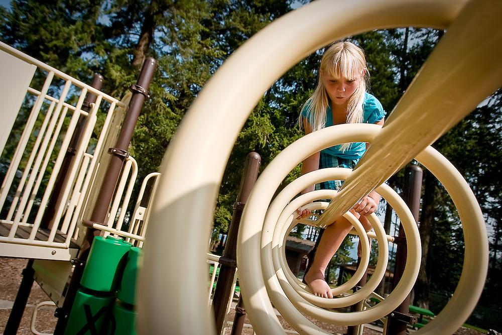JEROME A. POLLOS/Press..Sierra Woods, 10, climbs on the new playground equipment Thursday installed in Bayview adjacent to the U.S. Naval Acoustic Research Detachment. The project was completed through a collaborative effort with the City of Bayview, Kootenai County and the U.S. Navy.