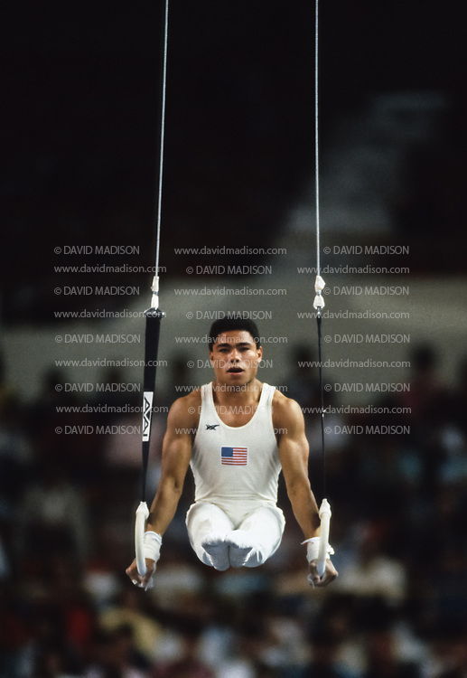 PHOENIX - APRIL 24:  Curtis Holdsworth of the United States competes on the still rings during a USA - USSR gymnastics meet on April 24, 1988  at the Arizona Veterans Memorial Coliseum in Phoenix, Arizona.  (Photo by David Madison/Getty Images)