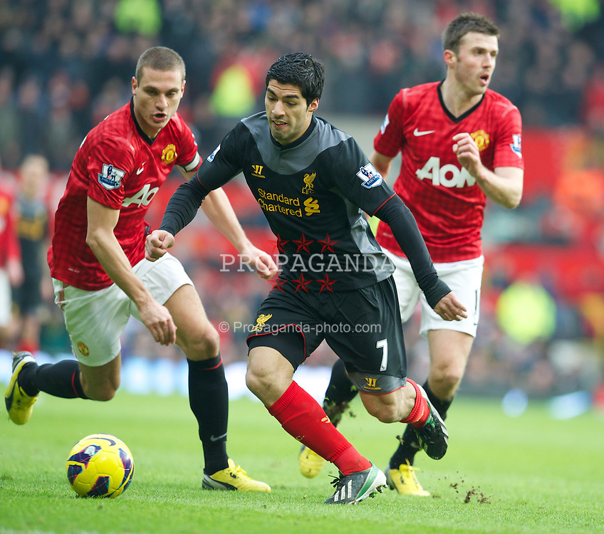 MANCHESTER, ENGLAND - Sunday, January 13, 2013: Liverpool's Luis Alberto Suarez Diaz in action against Manchester United during the Premiership match at Old Trafford. (Pic by David Rawcliffe/Propaganda)
