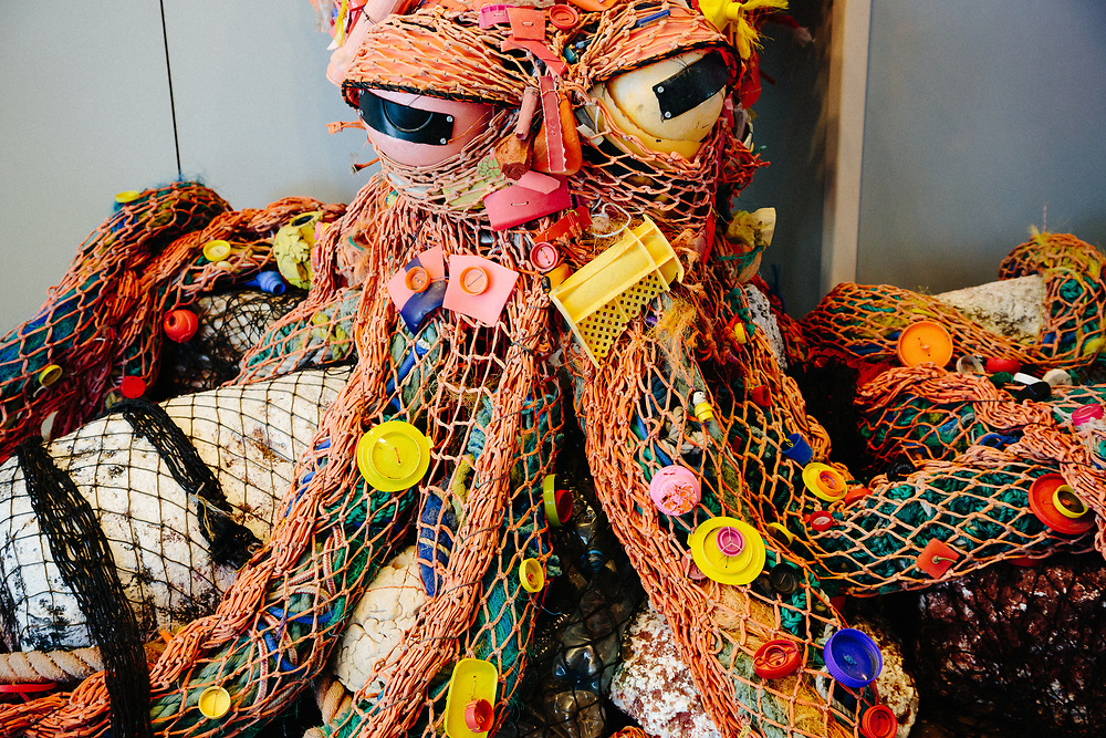 An octopus created entirely from ocean debris and trash designed as an environmental exhibit at the Seward Sealife Center.