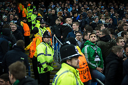 © Licensed to London News Pictures . 08/12/2015 . Manchester , UK . Police separate Borussia Monchengladbach and Manchester City fans after fans square off to each other during the UEFA Champions League match between Manchester City and Borussia Monchengladbach at the Etihad Stadium . Photo credit : Joel Goodman/LNP