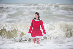 © Licensed to London News Pictures. 25/12/2017. Brighton, UK. 22 year old OLIVIA from Brighton takes part in the 2017 Christmas Day Swim in Brighton and Hove.Photo credit: Hugo Michiels/LNP