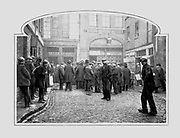 Unemployed workers queueing up at a soup kitchen, Gray's Yard, London, c1910.