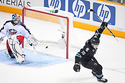 October 8, 2009; San Jose, CA, USA;  San Jose Sharks right wing Dany Heatley (15) celebrates after scoring his third goal of the game on a penalty shot against Columbus Blue Jackets goalie Mathieu Garon (32) during the the third period at HP Pavilion. Mandatory Credit: Jason O. Watson / US PRESSWIRE