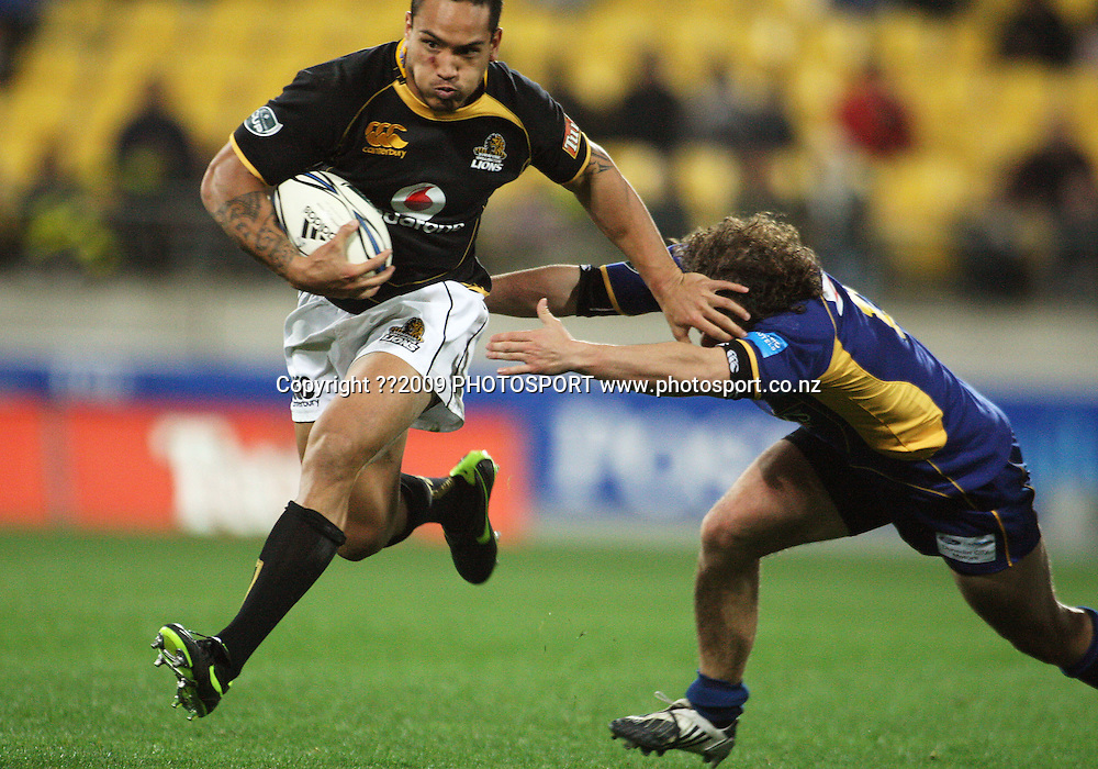 Wellington winger Hosea Gear gets past Andrew Parata.<br /> Air NZ Cup Ranfurly Shield match - Wellington Lions v Otago at Westpac Stadium, Wellington, New Zealand. Friday, 31 July 2009. Photo: Dave Lintott/PHOTOSPORT