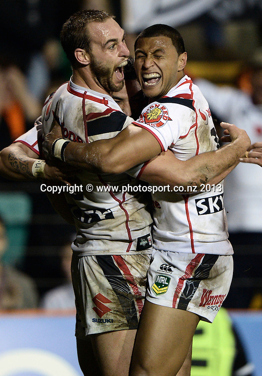 Simon Mannering celebrates with Dominique Peyroux after scoring a try. NRL Rugby League match, Vodafone Warriors v Wests Tigers at Leichhardt Oval in Sydney, Australia on Friday 19 July 2013. Photo: Andrew Cornaga/Photosport.co.nz