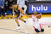 Houston Rockets guard Eric Gordon (10) reacts to being fouled by Golden State Warriors guard Klay Thompson (11) during Game 4 of the Western Conference Finals at Oracle Arena in Oakland, Calif., on May 22, 2018. (Stan Olszewski/Special to S.F. Examiner)