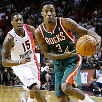 22 January 2012: Milwaukee Bucks point guard Brandon Jennings (3) drives to the basket past Miami Heat point guard Mario Chalmers (15) during the Milwaukee Bucks 91-82 victory over the Miami Heat at the AmericanAirlines Arena, Miami, Florida, USA.