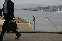Man walking along Cannes seafront South of France