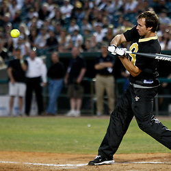 May 17, 2011; Metairie, LA, USA; New Orleans Saints quarterback Drew Brees (9) hits a homerun during the Heath Evans Foundation charity softball showdown featuring the offense versus the defensive players at Zephyrs Field.  Mandatory Credit: Derick E. Hingle