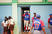 January 20, 2015 - Nueva Gerona, Cuba. Granma players (including star Alfredo Despaigne in the doorway) kill time on the street before a game against Isla de la Juventud with a few local girls, dressed in their school uniforms. 01/20/2015 Photograph by Joseph Swide/NYCity Photo Wire