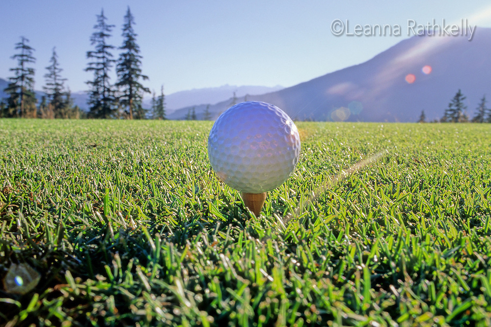 Golf Ball on a tee at the Chateau Whistler Golf Course in Whistler, BC Canada.