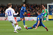 AFC Wimbledon defender Ben Purrington (3) sliding tackle on Luton Town midfielder Andrew Shinnie (11) during the EFL Sky Bet League 1 match between AFC Wimbledon and Luton Town at the Cherry Red Records Stadium, Kingston, England on 27 October 2018.