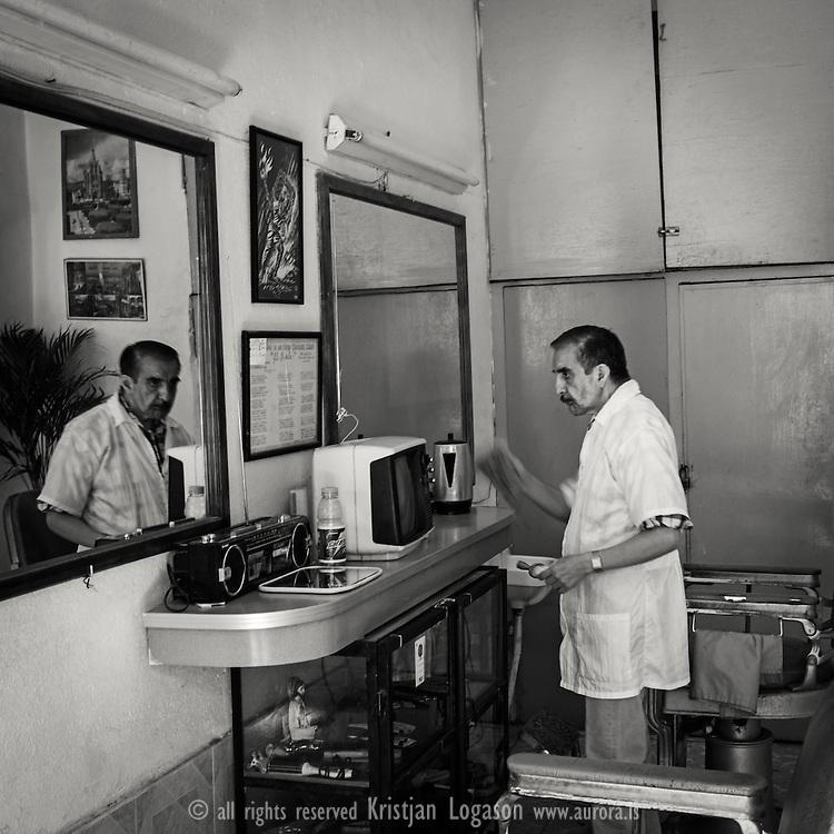 The old barber at his shop in San Miguel de Allende