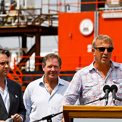 Ocean Therapy Solutions Chief Executive Officer, John Houghtaling II (left) and Ocean Therapy Solutions Chief Operating Officer, Patrick Smith (center) listen to founding partner of Ocean Therapy Solutions, Kevin Costner during a press conference about their oil separating centrifuge device that will be deployed by BP Plc that was demonstrated on a vessel at Hornbeck Offshore in Port Fourchon, Louisiana, U.S., on Tuesday, June 15, 2010. (Mandatory Credit: Derick E. Hingle)
