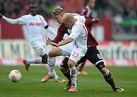 FUSSBALL   1. BUNDESLIGA  SAISON 2012/2013   8. Spieltag 1. FC Nuernberg - FC Augsburg       21.10.2012 Tobias Werner (re, FC Augsburg) gegen Sebastian Polter (1 FC Nuernberg)