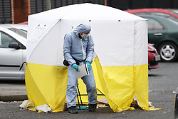 © Licensed to London News Pictures. 06/02/2019. London, UK. A forensics officer works near the crime scene on Westbridge Road in Battersea where a 19 year old man was fatally stabbed last night. Police have arrested two men. Photo credit: Peter Macdiarmid/LNP