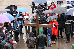 DATE CORRECTION © Licensed to London News Pictures. 30/3/2018. Wells, UK. Good Friday procession by parishioners of St Cuthbert's church through the city of Wells in Somerset . Photo credit: Jason Bryant/LNP