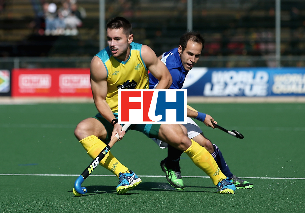 JOHANNESBURG, SOUTH AFRICA - JULY 11: Trent Mitton of Australia and Pieter van Straaten of France battle for possession during day 2 of the FIH Hockey World League Semi Finals Pool A match between Australia and France at Wits University on July 11, 2017 in Johannesburg, South Africa. (Photo by Jan Kruger/Getty Images for FIH)
