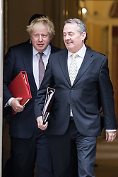 © Licensed to London News Pictures. 25/10/2016. London, UK. Foreign Secretary Boris Johnson (L) and Secretary of State for International Trade Liam Fox (R) leave Downing Street after the government sub-committee on airports, which is expected to green light the construction of a third runway at Heathrow airport. Photo credit: Rob Pinney/LNP