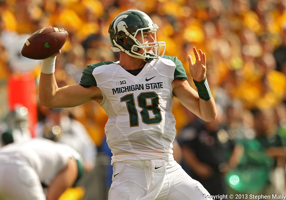 October 6 2013: Michigan State Spartans quarterback Connor Cook (18) passes the ball during the second half of the NCAA football game between the Michigan State Spartans and the Iowa Hawkeyes at Kinnick Stadium in Iowa City, Iowa on October 6, 2013. Michigan State defeated Iowa 26-14.