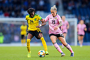 Den-Den Blackwood (#14) of Jamaica defends possession of the ball from Lana Clelland (#19) of Scotland during the International Friendly match between Scotland Women and Jamaica Women at Hampden Park, Glasgow, United Kingdom on 28 May 2019.