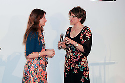 VICTORIA STAPLETON and KATE SILVERTON at the presentation of the Veuve Clicquot Business Woman Award 2010 held at the Institute of Contemporary Arts, 12 Carlton House Terrace, London on 23rd March 2010.  The winner was Laura Tenison - Founder and Managing Director of JoJo Maman Bebe.