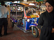 06 JULY 2011 - BANGKOK, THAILAND: A tuk-tuk (three wheeled taxi) navigates through the crowd in the Soi Arab neighborhood in Bangkok. Soi Arab is an alleyway in Bangkok. What started as an alley has now grown into a neighborhood that encompasses several blocks of restaurants, hotels and money exchanges that cater to Middle Eastern visitors to Thailand. The official name of the street is Sukhumvit Soi 3/1, located in North Nana between Sukhumvit Soi 3 and Sukhumvit Soi 5, not far from the Nana Plaza night-life area and the Grace Hotel popular among Arabs.   PHOTO BY JACK KURTZ