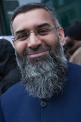 Brick Lane, London, December 13th 2013. Anjem Choudary leads his 'Sharia Project' as they demonstrate in Brick Lane against the consumption of Alchohol, blaming most of society's ills on drinking, and demanding that strict Sharia law be imposed to replace 'man-made' laws.