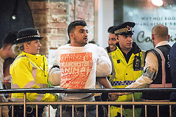 """© Licensed to London News Pictures . 16/11/2015 . Manchester , UK . Police and security detain a man at the event . Annual student pub crawl """" Carnage """" at Manchester's Deansgate Locks nightclubs venue . The event sees students visit several clubs over the course of an evening . This year's theme is """" Animal Instinct - unleash your beast """" . Photo credit : Joel Goodman/LNP"""