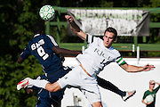 Rice's Clayton Scott (14) and Burlington's Joel Atutor (9) battle to head the ball during the boys soccer game between the The Burlington Seahorses and the Rice Green Knights at Rice Memorial high School on Tuesday afternoon September 15, 2015 in South Burlington, Vermont. (BRIAN JENKINS/for the FREE PRESS)