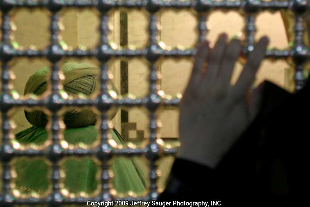 An Iranian woman mourns at the rock where Imam Hussein's head was set after the Iman Hussein was killed. Hussein was the son of Ali was the son-in-law of Muhammed and Ali was the first Shiite leader. Omayyad Mosque in Damascus, Syria on Saturday, July 12, 2003.