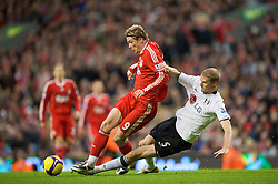 LIVERPOOL, ENGLAND - Saturday, November 22, 2008: Liverpool's Fernando Torres and Fulham's Brede Hangeland during the Premiership match at Anfield. (Photo by David Rawcliffe/Propaganda)
