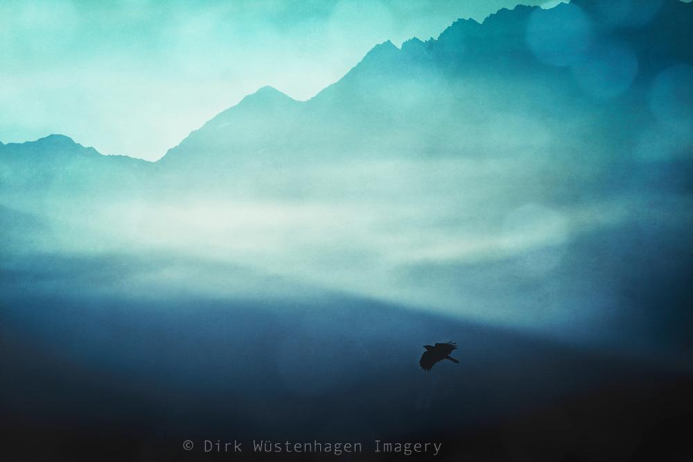 Dissolving morning fog in the Italian Alps on a summer morning