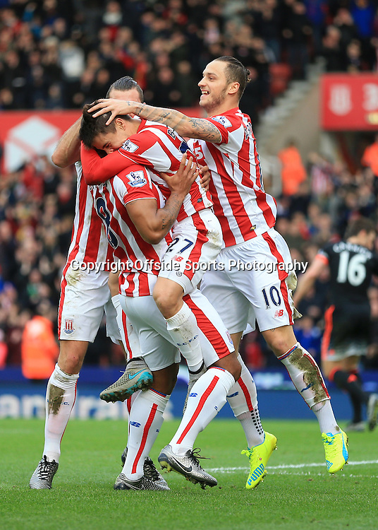 26th December 2015 - Barclays Premier League - Stoke City v Manchester United - Bojan Krkic of Stoke celebrates with teammate Marko Arnautovic of Stoke (R) after scoring their 1st goal - Photo: Simon Stacpoole / Offside.