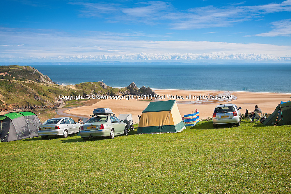 Cars and tents overlooking beach<br /> Three Cliffs Bay Holiday Park<br /> Gower Peninsula<br /> County of Swansea<br /> South<br /> Camping and Caravanning<br /> Accommodation