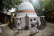 Devotees visit Gangarama Vihara Temple in Colombo, Sri Lanka on July 22, 2015. The one of the major temple complexes in the country has a library, a museum and an eclectic array of gifts presented by devotees.<br /> (Photo by Kuni Takahashi)