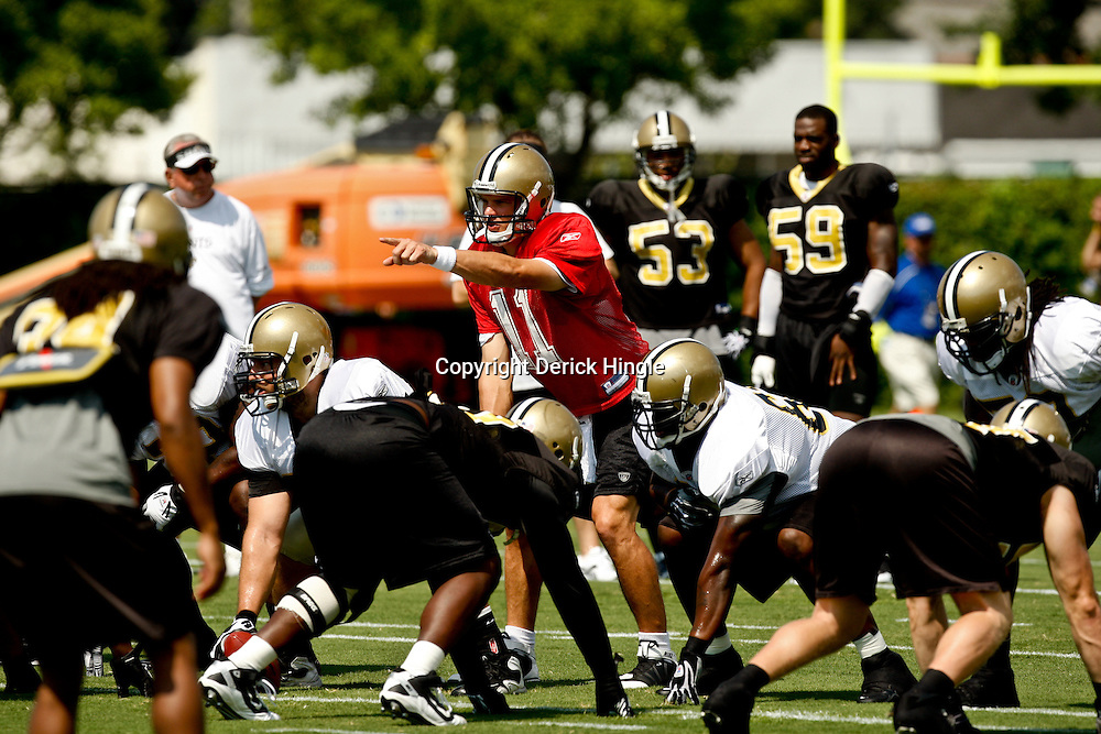 August 1, 2010; Metairie, LA, USA; New Orleans Saints quarterback Patrick Ramsey (11) under center during a training camp practice at the New Orleans Saints practice facility. Mandatory Credit: Derick E. Hingle