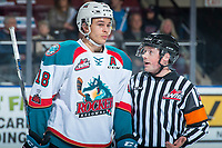 KELOWNA, CANADA - MARCH 14: Carsen Twarynski #18 of the Kelowna Rockets speaks to referee Colin Watt during second period against the Prince George Cougars  on March 14, 2018 at Prospera Place in Kelowna, British Columbia, Canada.  (Photo by Marissa Baecker/Shoot the Breeze)  *** Local Caption ***